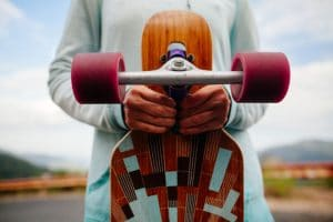 girl-with-longboard-in-hands-closeup