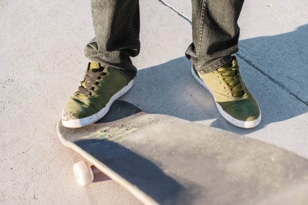 Use your front foot to flick the board