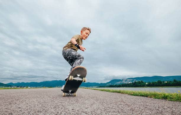 Catch the skateboard with your back foot, then your front
