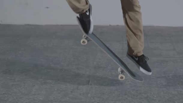 Slide your front foot alongside the board