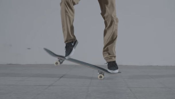 Use your back foot to pop the board up