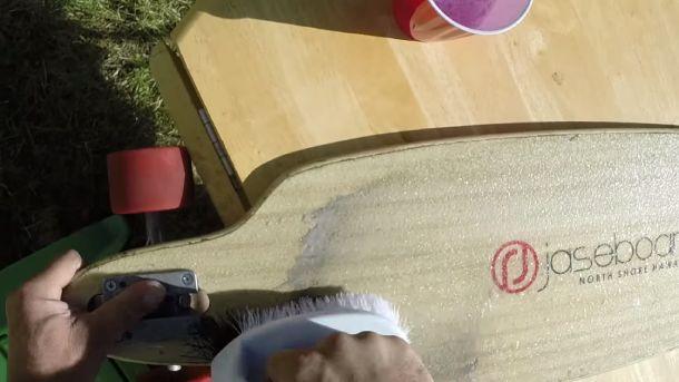 Cleaning griptape on a longboard